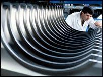 Corus worker checking aluminium