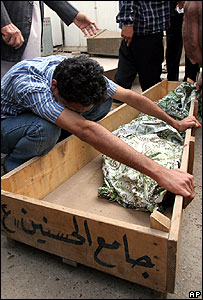 An Iraqi relative weeps over the body of a child in Baghdad, November 2006