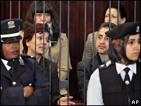 Four of the group behind bars at the court in Tripoli