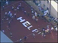 """Detainees spell out """"help"""" with bedsheets"""