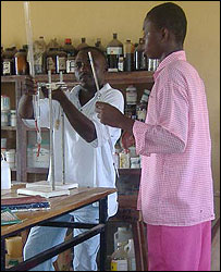 Student and teacher in laboratory, Nigeria