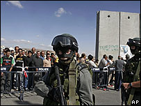 Israel border police guarding a gap in the barrier