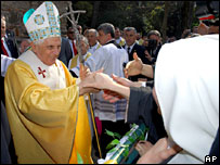 Nuns greet Pope Benedict XVI as he arrives in Ephesus