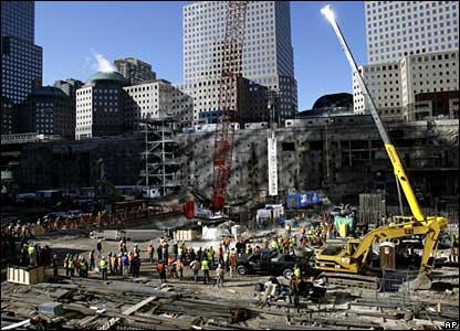 A crane lowers the first beam of the Freedom Tower into place