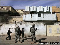 US soldiers patrol a tense neighbourhood of Baghdad (2 December)