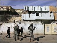 US soldiers patrol a tense neighbourhood of Baghdad (2 December)