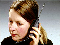 Woman with old mobile phone