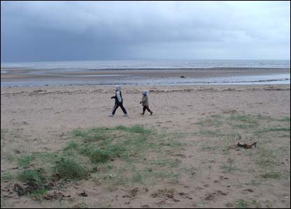 Ryan and Owain enjoying Swansea Bay despite the rain (Sara McEwan-Green)