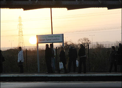Commuters waiting for the train to Cardiff as the sun rises at Severn Tunnel Junction railway station (Rob Carey)