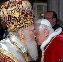 Pope Benedict and Patriarch Bartholomew exchange the kiss of peace