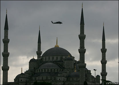 A Turkish army helicopter patrols over the Blue Mosque prior to the Pope's visit
