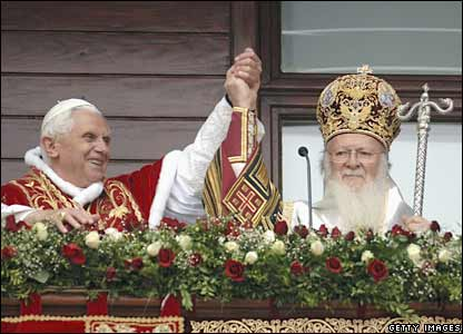 Pope Benedict XVI and Ecumenical Patriarch Bartholomew I hold each others hand as they stand on the balcony of the Ecumenical Patriarchate in Istanbul