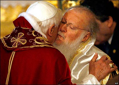 Pope Benedict XVI and Ecumenical Patriarch Bartholomew I kiss each other during a divine liturgy at the Patriarchal Church of St George