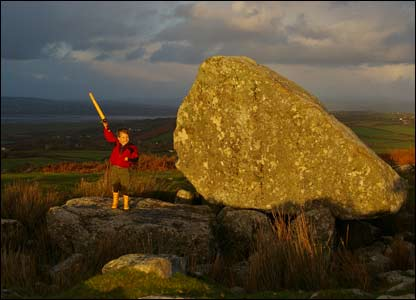 Rhys Morgan Evans from York, Maine, USA visited King Arthur's Stone at Cefn Bryn, Gower with his dad Richard