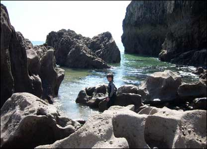 Mike O'Keefe's son Rhys rock pooling on the Pembrokeshire coast