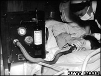 Woman in labour breathes in gas and air (entonox) - late 1940s