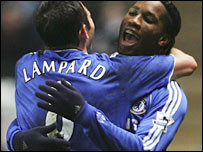 Frank Lampard congratulates Didier Drogba after his winner