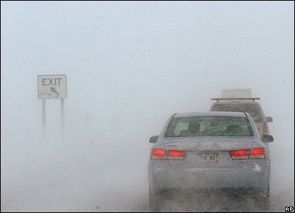 Drivers approach Denver International Airport in white-out driving conditions