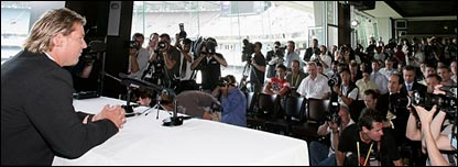 Warne faces the cameras in Melbourne