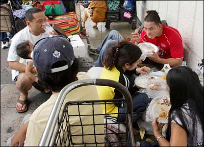 Stranded passengers take their meal at Manila's domestic airport