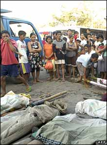 Villagers looked at recovered bodies in the Albay province