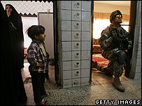 US soldier on a weapons search in a Baghdad house