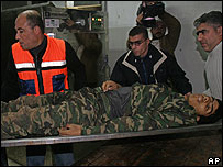 Injured Palestinian security man is carried in Shifa hospital