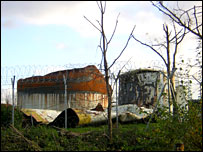 Two burnt out tanks at Buncefield (Dec 2006)