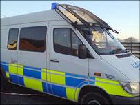 The men were taken away in a police van