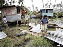 Destroyed houses in the Sarangani village, Quezon province