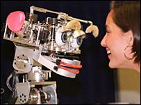 Researcher gazes at a robot