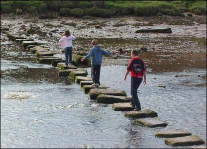 Mari, Sam and Thomas crossing the stepping stones at Cresswell Quay, sent by Rob Phillips