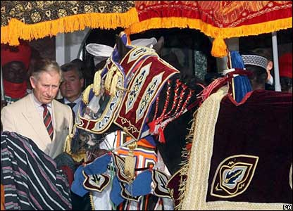 Prince Charles is presented with a horse at a durbar in Kano, northern Nigeria
