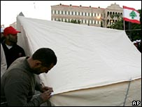 Lebanese Hezbollah supporter sets up a tent
