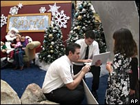 Demonstrating a laptop in Santa's grotto