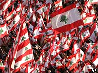 Flags are waved at a protest against the Lebanese government