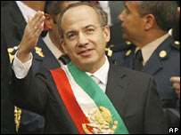 Mexican President Felipe Calderon waves after being sworn in.