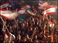 Demonstrators waving flags in Beirut