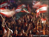 Demonstrators waving flags in Beirut