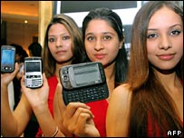 Indian models with mobile handsets
