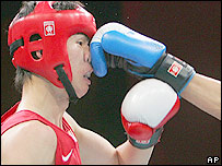 Boxer being punched in the nose