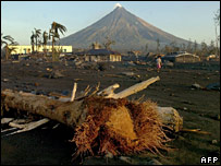 An uprooted tree in Busay village, with Mayon in the background