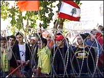 Lebanese protesters stand by barricades surrounding the government offices