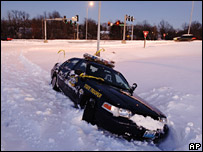 A Missouri State Highway Patrol sits in a snow bank on Friday 1 December