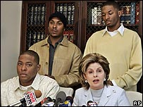 Attorney Gloria Allred (bottom right) with her clients (l to r), Kyle Doss, Patrick McLucas and Frank McBride