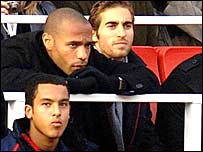 Theo Walcott, Thierry Henry and Mathieu Flamini watch the north London derby from the stands