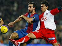 Barcelona's Oleguer and Atletico Madrid's Sergio Aguero