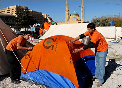 Supporters of Christian opposition leader Michel Aoun set up a tent
