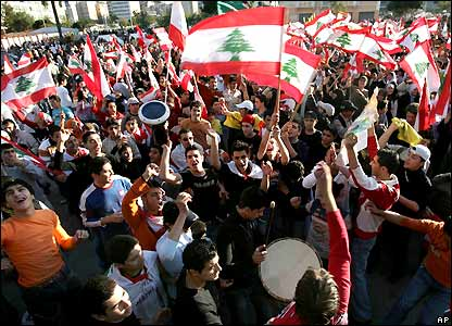 Opposition protesters wave flags