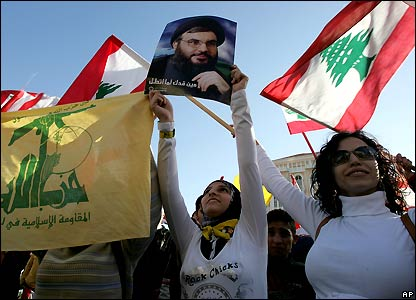 Opposition supporters wave Hezbollah and Lebanese flags